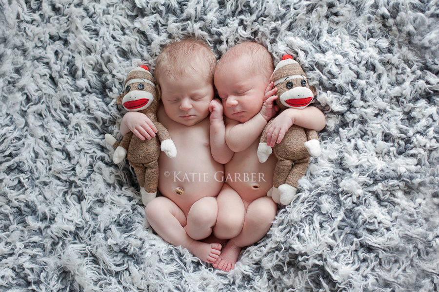 babies holding sock monkeys