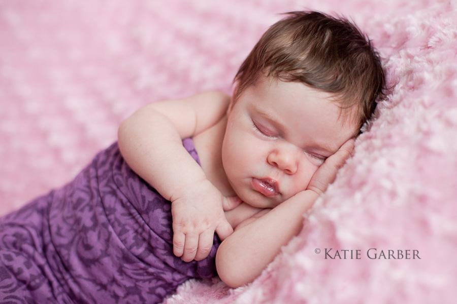 baby girl in purple wrap