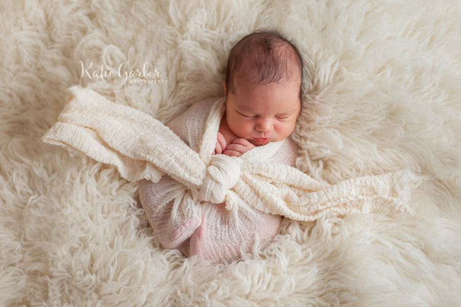 baby in cheesecloth wrap
