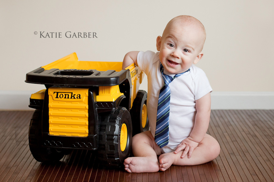 baby with dump truck
