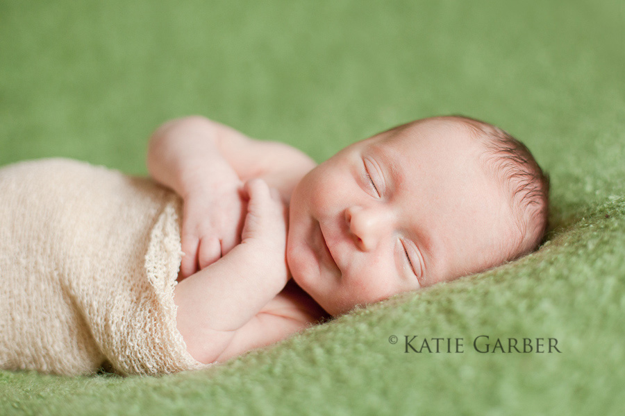 newborn baby smiling in sleep