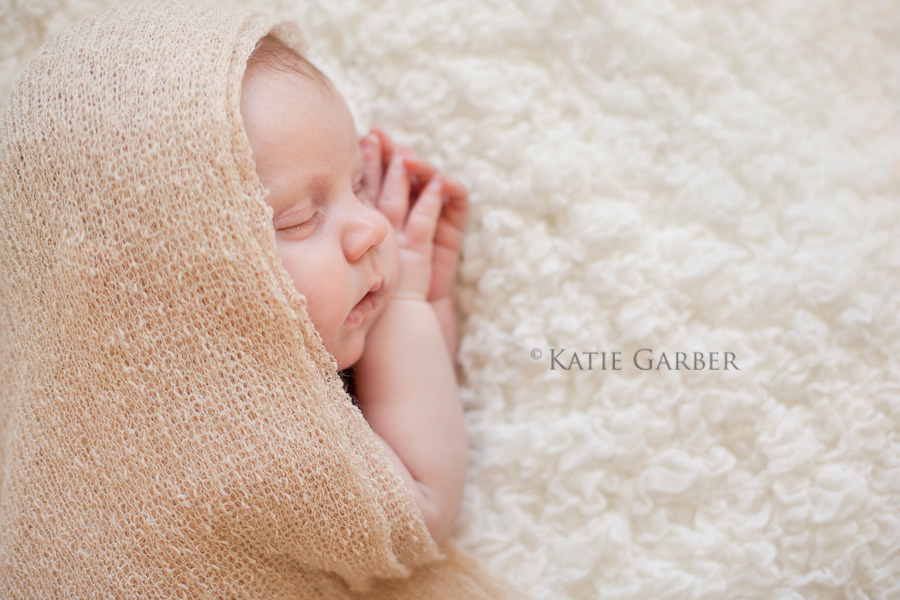 newborn baby wearing wrap