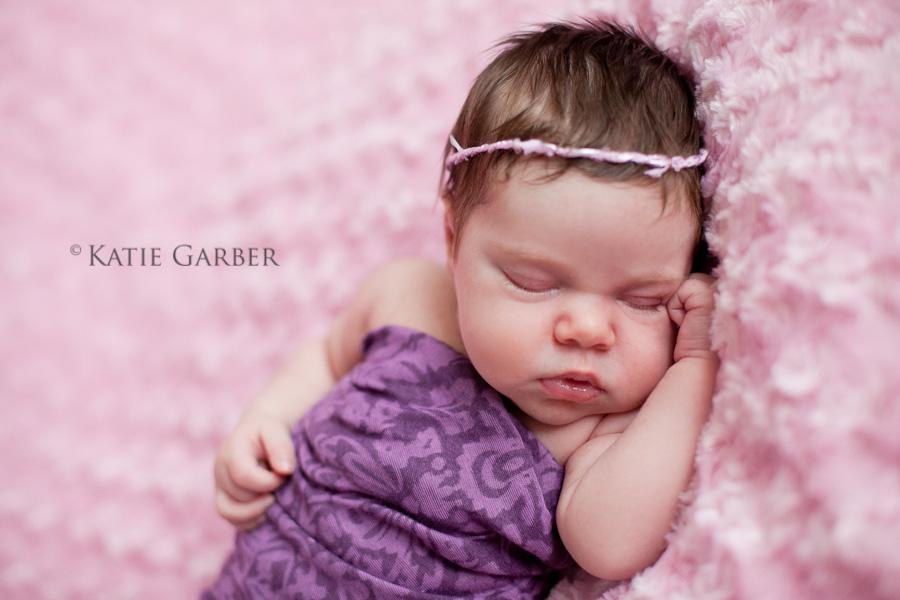 newborn swaddled with headband