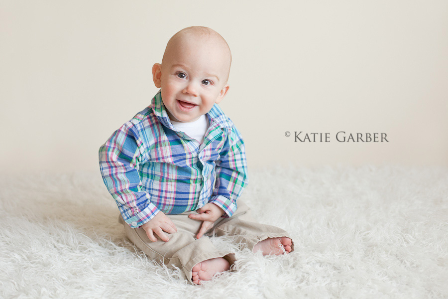 smiling baby on furry rug