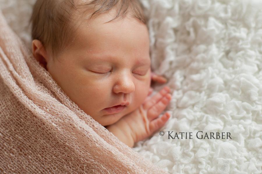 baby girl cuddled in blanket