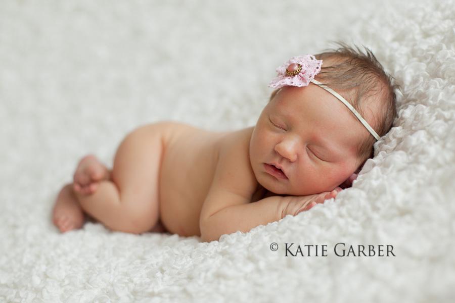 newborn girl with flower headband