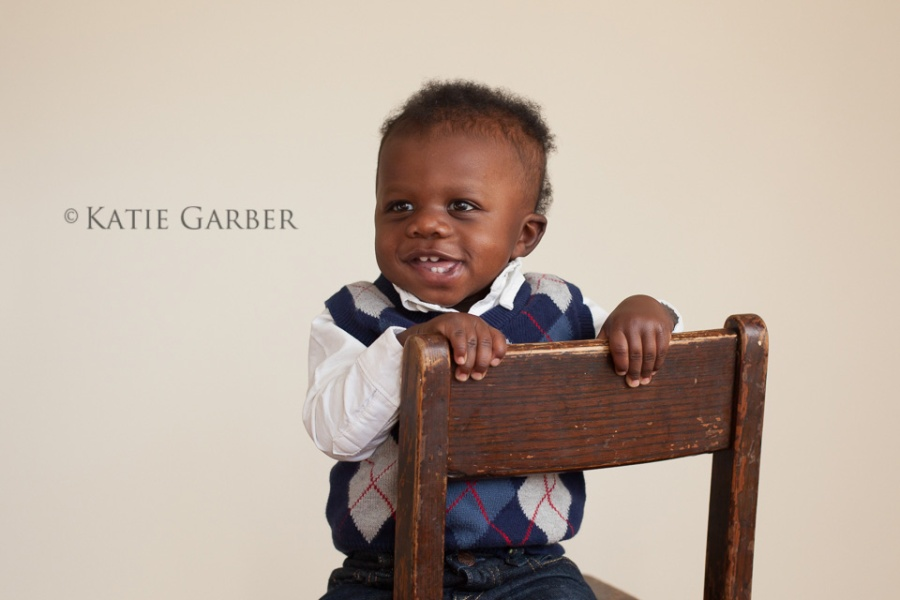 smiling boy on chair