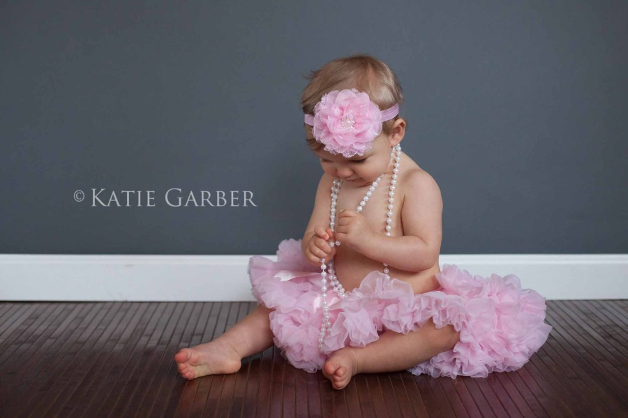 baby playing with pearls