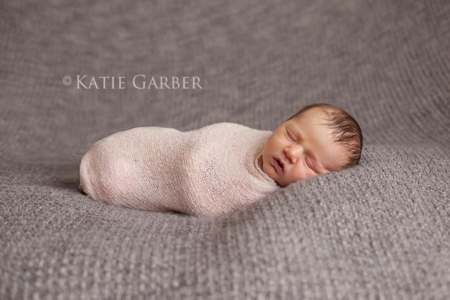 baby girl in stretch wrap