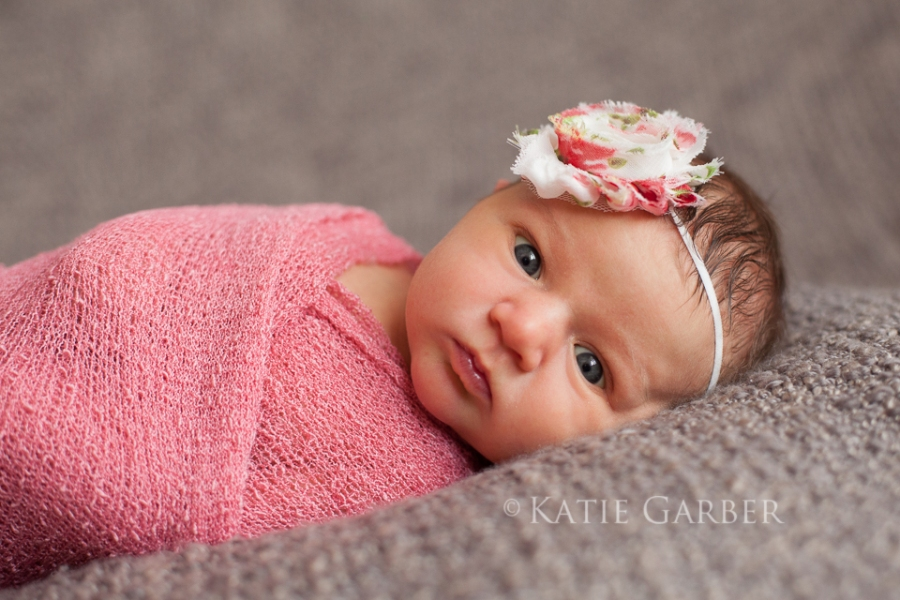 newborn wearing flower headband