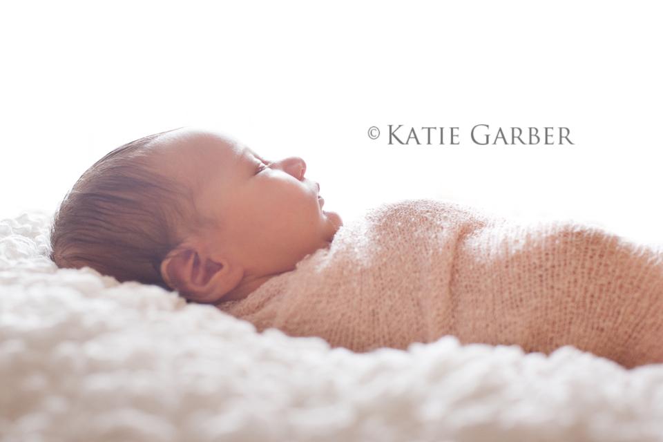 swaddled newborn backlighting
