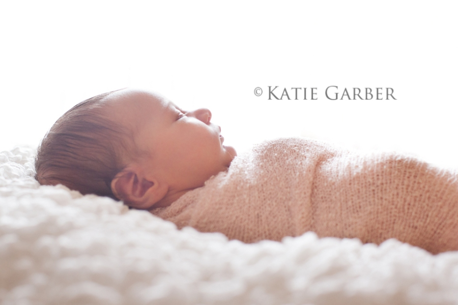 swaddled newborn backlighting