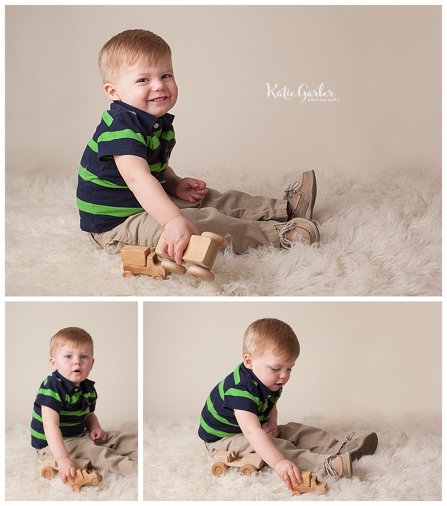toddler boy playing with wooden cars