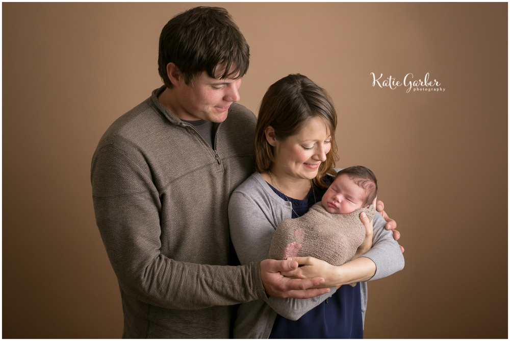 newborn family of three