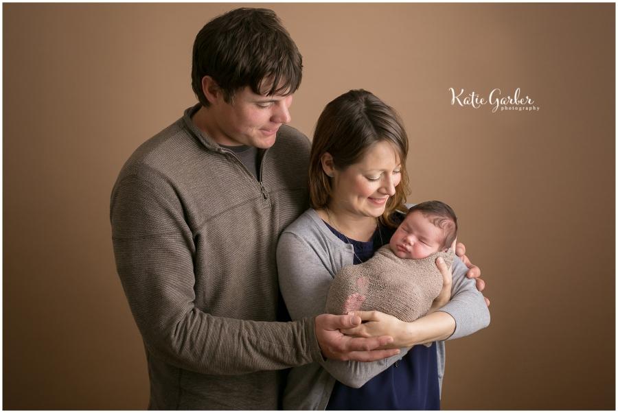 newborn family of three