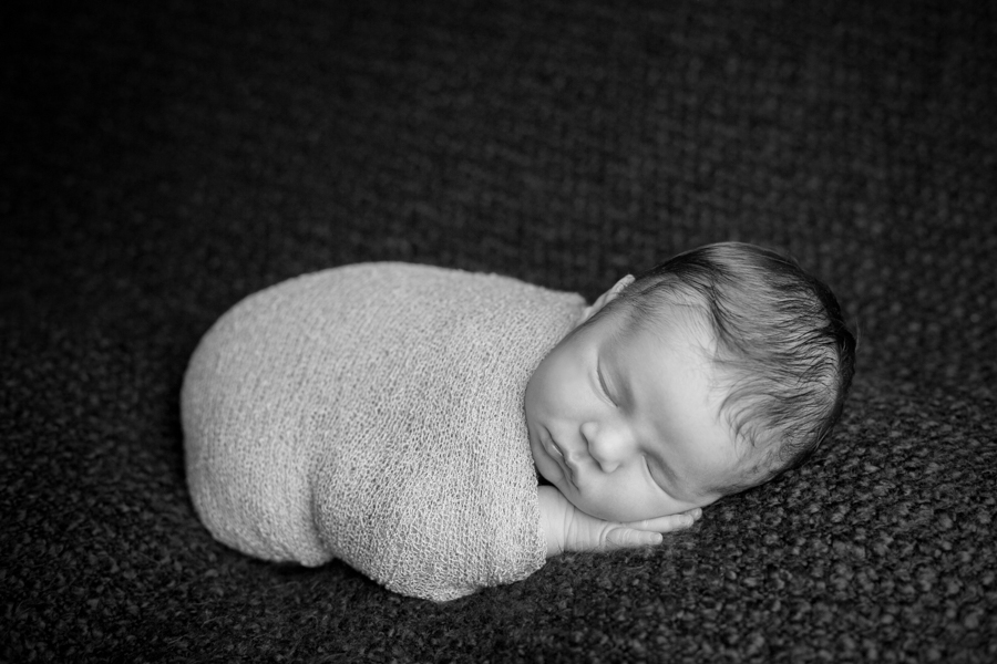 newborn baby wrapped boy sleeping